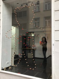 Starting the performance - shooting the toy guns to the window
